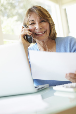 Foto per Senior Hispanic Woman Working In Home Office - Immagine Royalty Free