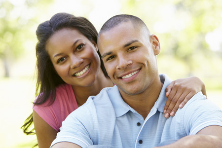 Photo for Portrait Of Romantic Young African American Couple In Park - Royalty Free Image