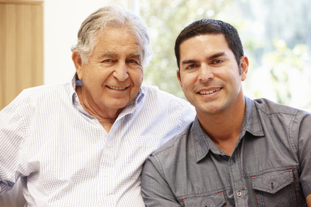 Photo for Hispanic father and adult son - Royalty Free Image