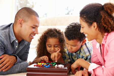 Photo for Mixed race family playing solitaire - Royalty Free Image