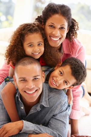Photo pour Mixed race family at home - image libre de droit