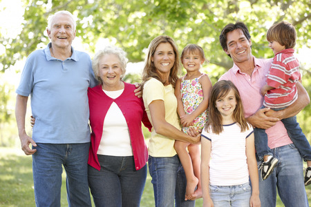 Photo for Multi-generation family in park - Royalty Free Image