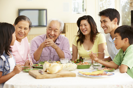 Photo for Asian family sharing meal at home - Royalty Free Image