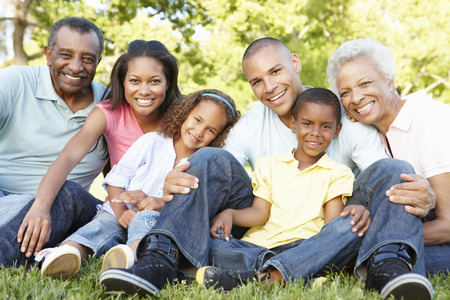 Photo for Multi Generation African American Family Relaxing In Park - Royalty Free Image