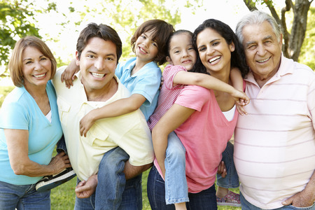 Photo for Multi Generation Hispanic Family Standing In Park - Royalty Free Image