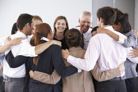 Photo for Group Of Businesspeople Bonding In Circle At Company Seminar - Royalty Free Image
