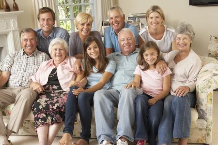 Photo pour Large Family Group Sitting On Sofa Indoors - image libre de droit