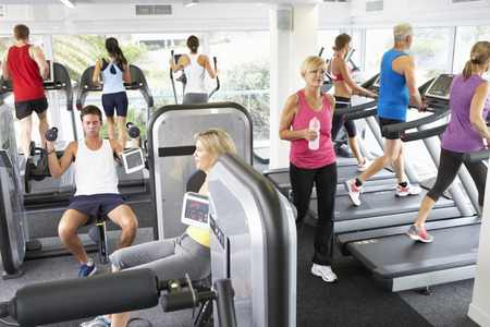 Photo for Elevated View Of Busy Gym With People Exercising On Machines - Royalty Free Image