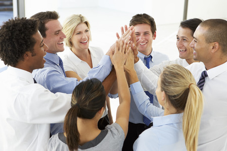 Photo pour Close Up Of Business People Joining Hands In Team Building Exercise - image libre de droit