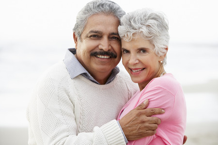 Photo for Romantic Senior Couple Hugging On Beach - Royalty Free Image