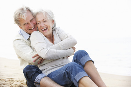 Photo for Senior Couple Sitting On Beach Together - Royalty Free Image