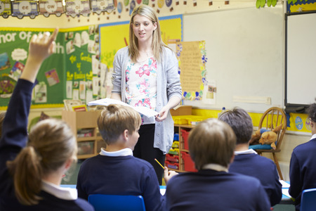 Photo for Teacher Teaching Lesson To Elementary School Pupils - Royalty Free Image
