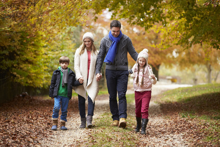 Photo for Family Walking Along Autumn Path - Royalty Free Image