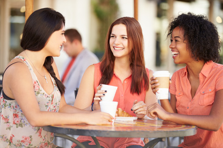 Photo for Three Female Friends Meeting In CafŽ - Royalty Free Image