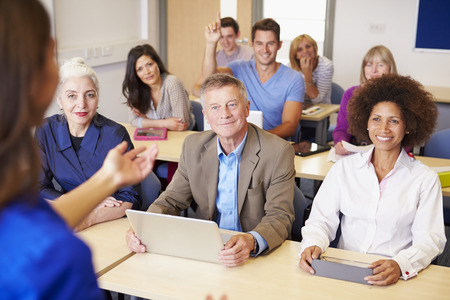 Photo for Mature Students In Further Education Class With Teacher - Royalty Free Image