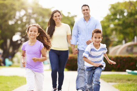 Photo for Hispanic Family Walking In Park Together - Royalty Free Image