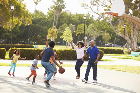 Photo for Multi Generation Family Playing Basketball Together - Royalty Free Image