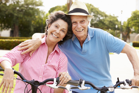 Photo for Senior Hispanic Couple Riding Bikes In Park - Royalty Free Image