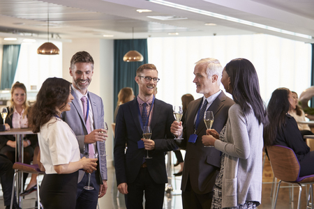 Photo for Delegates Networking At Conference Drinks Reception - Royalty Free Image