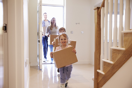 Photo for Family Carrying Boxes Into New Home On Moving Day - Royalty Free Image