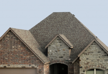 Photo pour House with a new shingle roof and roof vent - image libre de droit