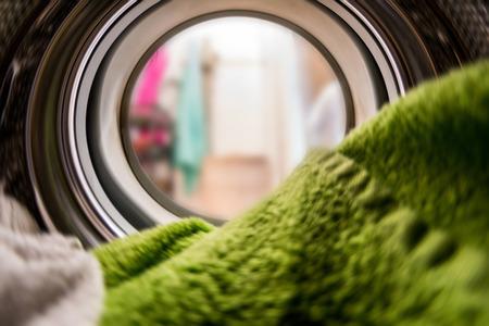 Foto de Color clothes in washing machine. inside view - Imagen libre de derechos