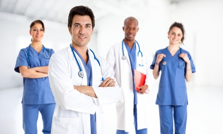 Photo for Portrait of a smiling doctor in front of his team - Royalty Free Image