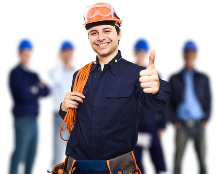 Photo for Portrait of an happy worker in front of his team - Royalty Free Image