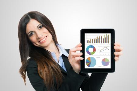 Foto de Businesswoman showing financial reports on a tablet computer - Imagen libre de derechos