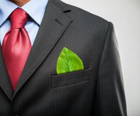 Foto für Ecology concept, businessman keeping a green leaf in his pocket - Lizenzfreies Bild