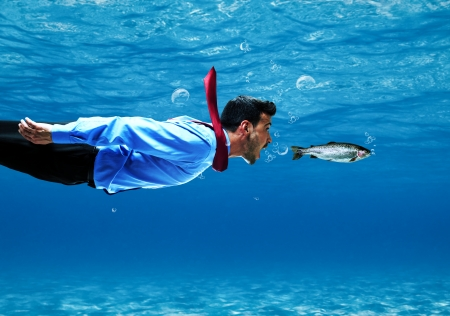 Photo pour Funny businessman swimming underwater - image libre de droit