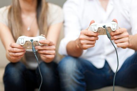 Photo pour Young couple playing video games - image libre de droit