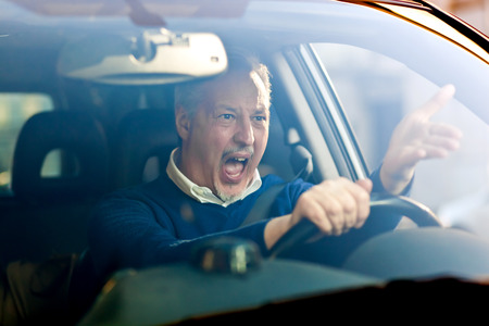 Angry driver shouting in his car