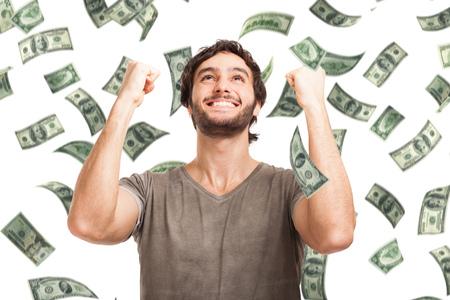 Photo pour Portrait of a very happy young man in a rain of money - image libre de droit