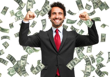 Photo pour Happy man enjoying the rain of money - image libre de droit