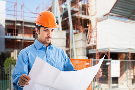 Photo for Portrait of an architect at work in a construction site - Royalty Free Image