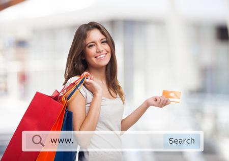 Foto de Young woman holding shopping bags - Imagen libre de derechos