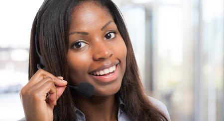Foto de Portrait of a smiling customer representative - Imagen libre de derechos