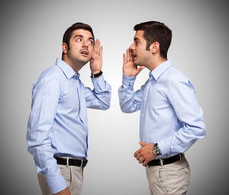 Photo pour Man talking to a clone of himself - image libre de droit