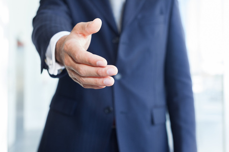 Foto per Close-up of a businessman offering an handshake - Immagine Royalty Free