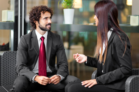 Photo for Couple of business people talking - Royalty Free Image