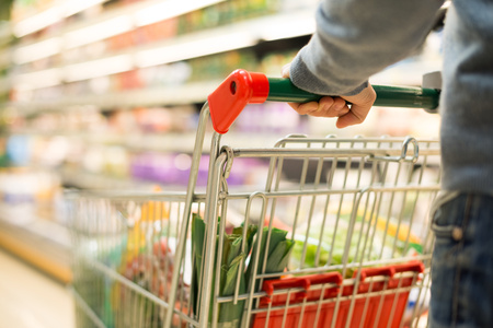 Photo for Close-up detail of a man shopping in a supermarket - Royalty Free Image