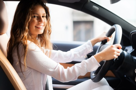 Photo for Young woman driving her car - Royalty Free Image