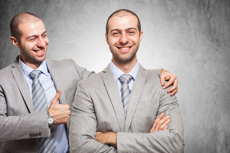 Photo for Smiling businessman congratulating with himself - Royalty Free Image