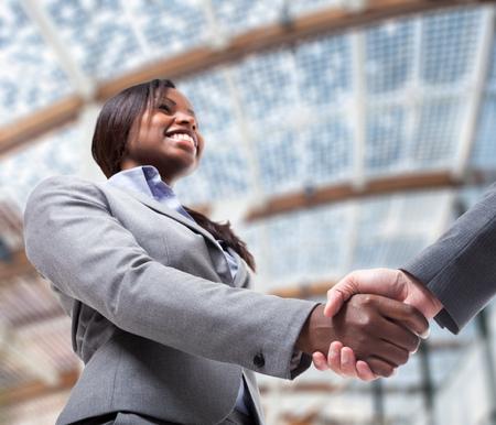 Foto de Business people shaking their hands to seal a deal - Imagen libre de derechos