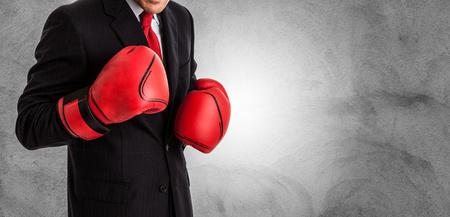 Foto de Businessman with boxing gloves ready to fight - Imagen libre de derechos