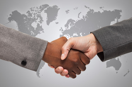 Photo for Handshake between white and black business people - Royalty Free Image