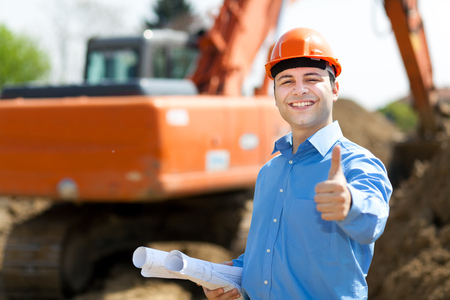 Photo pour Architect showing ok sign in a construction site - image libre de droit