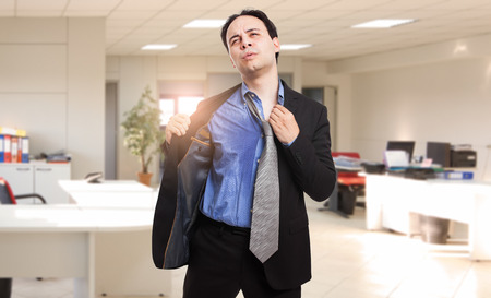 Photo for Sweating businessman due to hot climate - Royalty Free Image