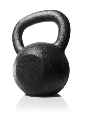 Photo for Rough and tough heavy kettlebell made of cast iron. - Royalty Free Image